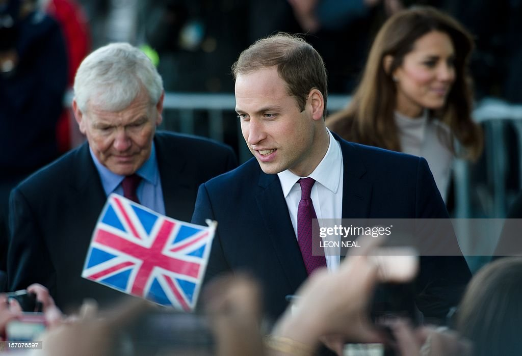 Britain's Prince William, Duke of Cambridge (L) speaks with members of the public as he and Britain's Catherine, Duchess of Cambridge (R) arrive for a visit to Peterborough City Hospital in Peterborough, Cambridgeshire, north of London, on November 28, 2012. Britain's Prince William and his wife Catherine visited the university city that is home to their dukedom on November 28 for the first time since they were given their official titles. AFP PHOTO / LEON NEAL