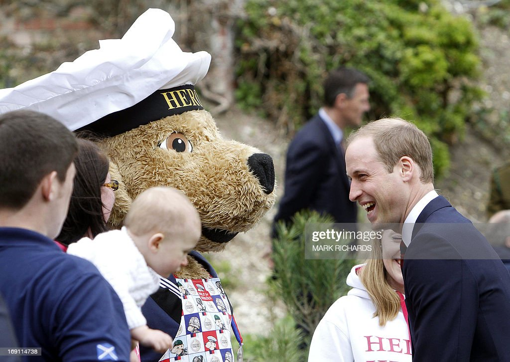 Britain's Prince William, Duke of Cambridge (R), speaks with people during a visit to Tedworth House, a recovery centre run by the Help for Heroes charity that offers care and support to injured service personnel, in Tidworth, Wiltshire, southern England, on May 20, 2013. The Duke of Cambridge and Prince Harry will officially open four new Help for Heroes recovery centres, which form part of the Defence Recovery Capability. AFP PHOT/POOL/MARK RICHARDS
