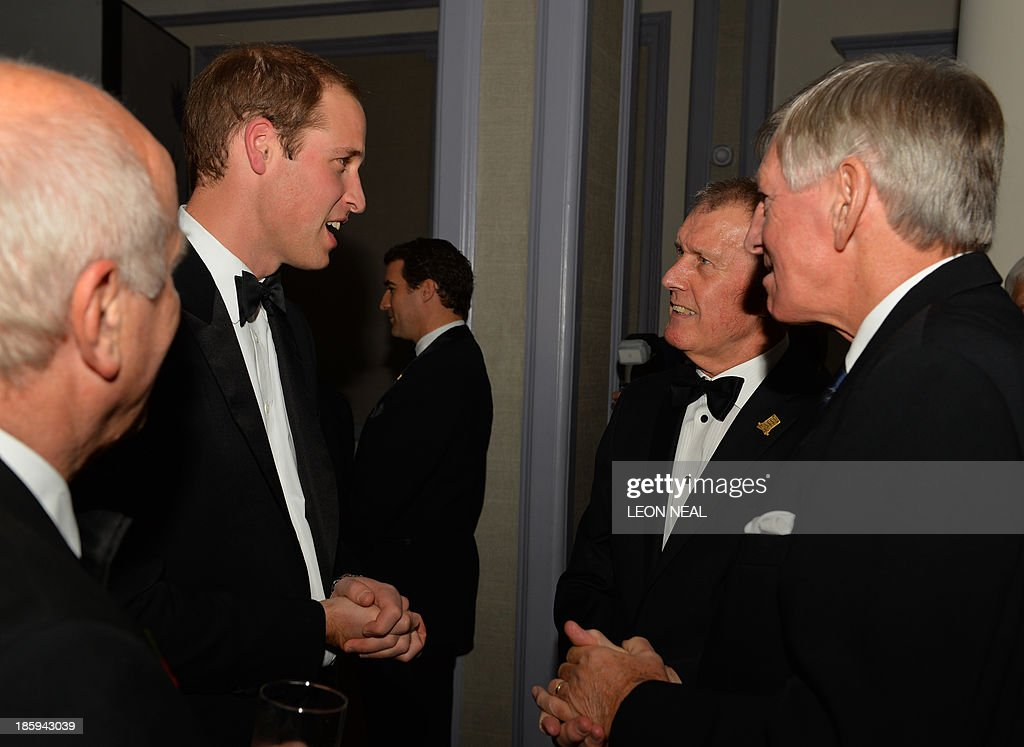 Britain's Prince William, Duke of Cambridge (L) talks to 1966 England World Cup team members Geoff Hurst (2nd R) and Martin Peters (R) as he attends The Football Association's 150th Anniversary Gala Dinner at the Grand Connaught Rooms in central London on October 26, 2013. The Duke of Cambridge is president of the Football Association, which was founded 150 years ago on October 26, 1863. The event marks the day when a group of men representing a dozen London and suburban clubs met at the Freemason's Tavern in London, to draw up the rules of a sport that went on to become the most popular in the world. AFP PHOTO/POOL/LEON NEAL