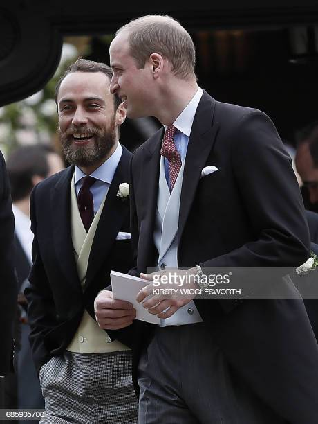 Britain's Prince William Duke of Cambridge talks to James Middleton after the wedding of Pippa Middleton and James Matthews at St Mark's Church in...