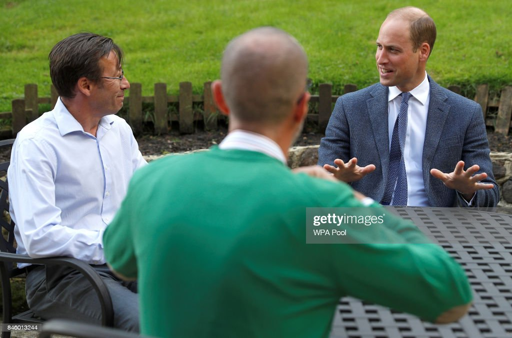 Britain's Prince William, Duke of Cambridge talks with Ian Ackley (L), and another survivor of non-recent sexual abuse at the residential centre of charity Sporting Chances on September 12, 2017 in Liphook, United Kingdom..