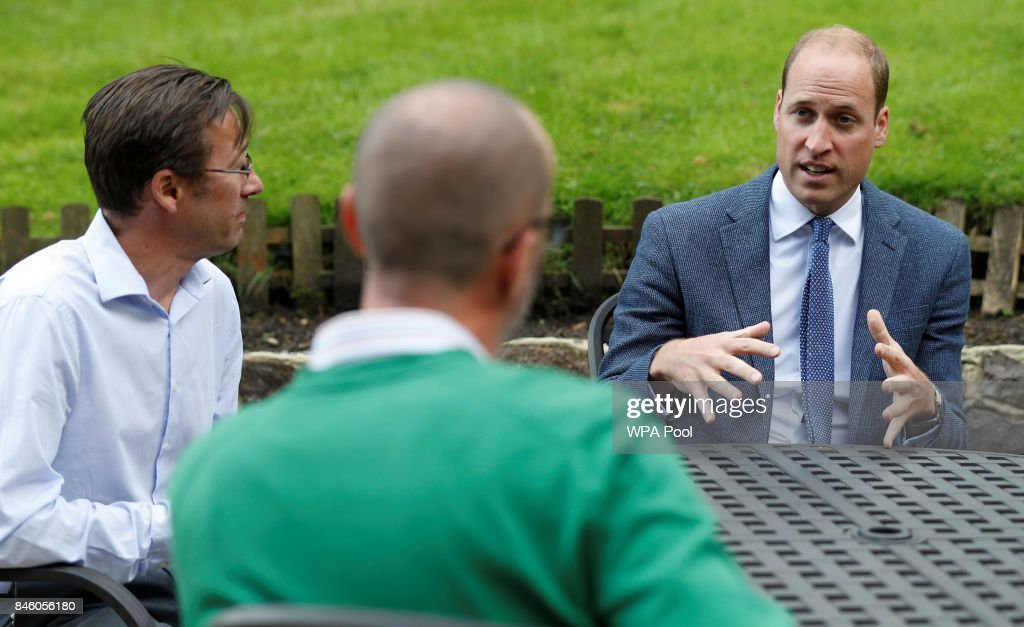 Britain's Prince William, Duke of Cambridge talks with Ian Ackley (L), and another survivor of non-recent sexual abuse at the residential centre of charity Sporting Chances on September 12, 2017 in Liphook, United Kingdom.