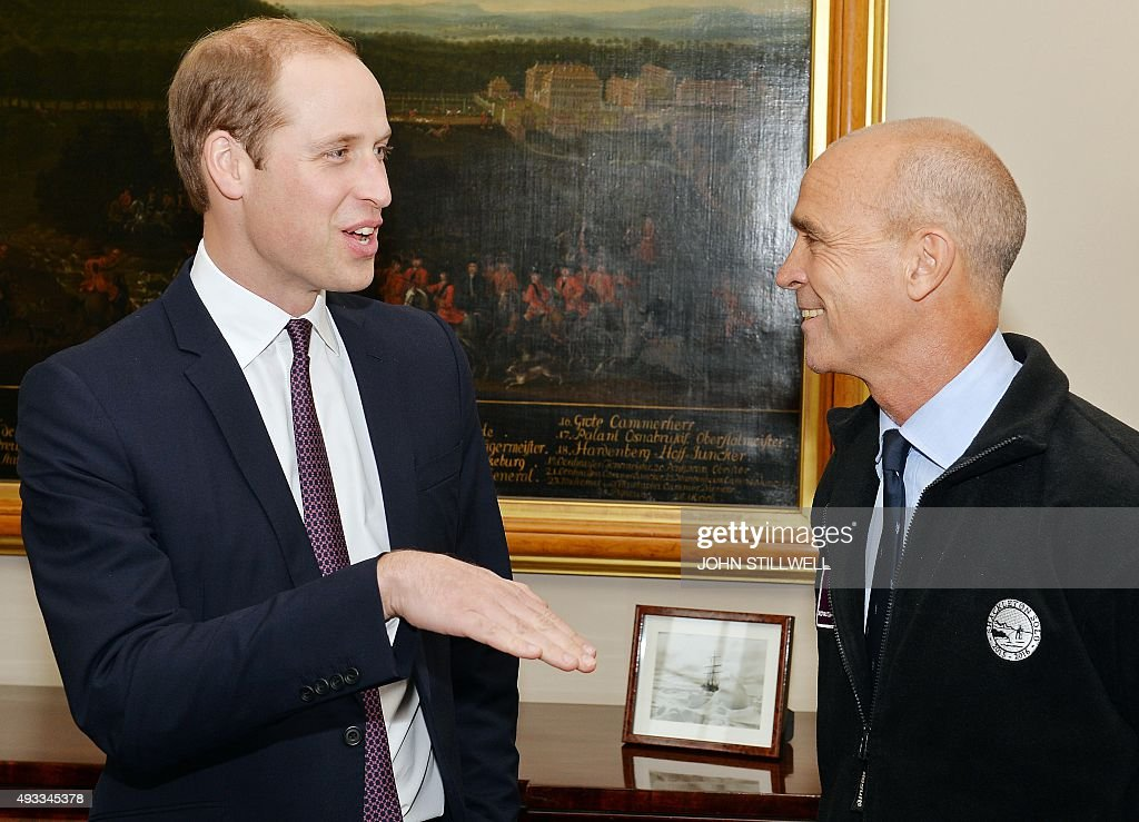 Britain's Prince William, Duke of Cambridge, (L) talks with polar explorer Henry Worsley at Kensington Palace in London on October 19, 2015. Worsley will undertake the 2015/16 Shackleton solo challenge starting in November, and attempting to undertake Sir Ernest Shackleton's unfinished journey to the South Pole from the Weddell Sea.