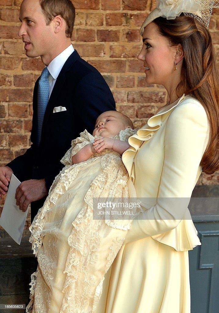 Britain's Prince William, Duke of Cambridge, walks alongside his wife Catherine, Duchess of Cambridge, as she holds their son Prince George of Cambridge, following his Christening at Chapel Royal in St James's Palace in central London on October 23, 2013. Britain's Prince William and his wife Catherine named the godparents for their baby son Prince George, as they gathered close friends and family for a low-key christening far removed from the global hype surrounding his birth.