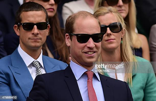 Britain's Prince William Duke of Cambridge wears sunglasses as he watches the action in the royal box on centre court during the men's singles...