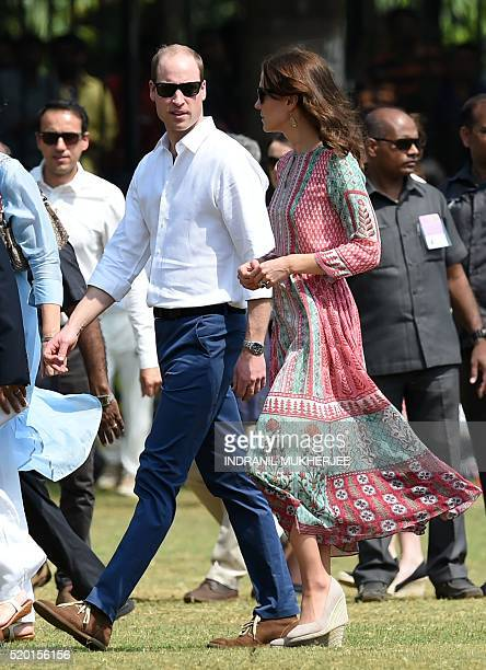 Britain's Prince William Duke of Cambridgeand Catherine Duchess of Cambridgewalk with officials during a charity event at The Oval Maidan in Mumbai...