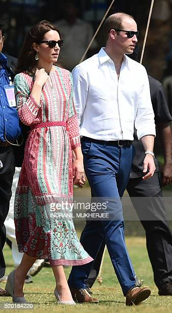 Britain's Prince William Duke of Cambridgeand Catherine Duchess of Cambridge walk during a charity function at The Oval Maidan in Mumbai on April 10...