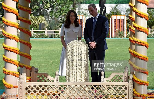 Britain's Prince William Duke of Cambridgeand his wife Catherine Duchess of Cambridge speak as they pay tribute during a visit to Gandhi Smiriti an...