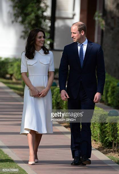 Britain's Prince William Duke of Cambridgeand his wife Catherine Duchess of Cambridge walk as they pay tribute during a visit to Gandhi Smiriti an...