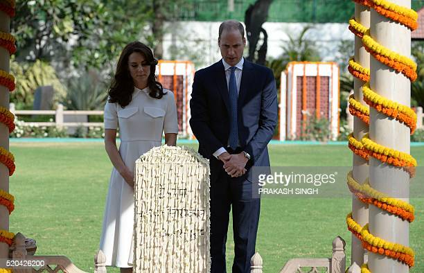 Britain's Prince William Duke of Cambridgeand his wife Catherine Duchess of Cambridge bow their heads as they pay tribute during a visit to Gandhi...