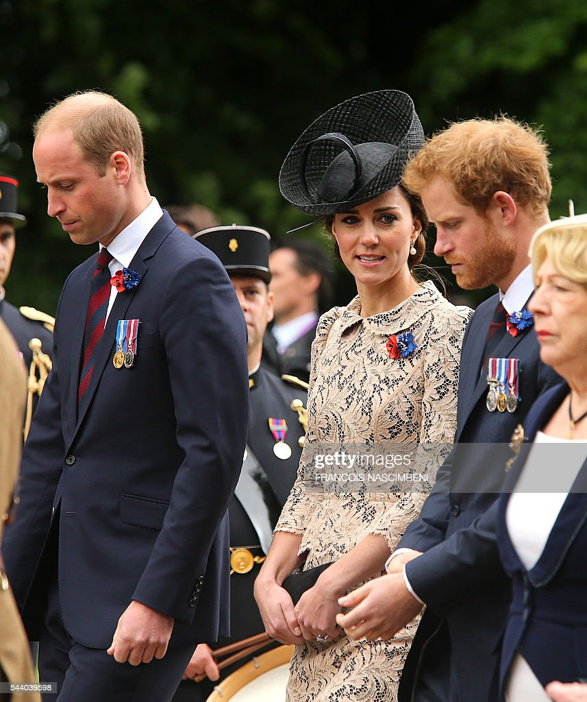 Britain's Prince William, his wife Catherine and Britain's Prince Harry march towards the Thiepval Memorial to attend a ceremony marking the 100th anniversary of the World War I battle at the River Somme. Under grey skies, unlike the clear sunny day that saw the biggest slaughter in British military history a century ago, the commemoration kicked off at the deep Lochnagar crater, created by the blast of mines placed under German positions two minutes before the attack began at 7:30 am on July 1, 1916. / AFP / FRANCOIS
