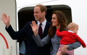 Britain's Prince William his wife Catherine and their son Prince George depart Australia from Defence Establishment Fairbairn in Canberra on April 25...