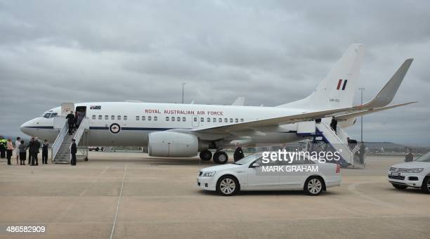 Britain's Prince William his wife Catherine the Duchess of Cambridge and their son Prince George depart Australia from Defence Establishment...