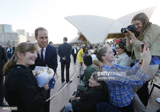 Britain's Prince William poses for a picture with the crowd including someone taking a 'selfie' following a reception at the Sydney Opera House on...