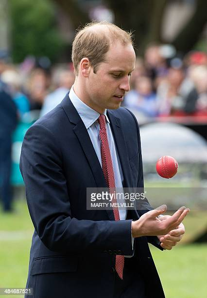 Britain's Prince William prepares to bowl the ball to his wife Catherine the Duchess of Cambridge as they play a game of cricket during a visit to...