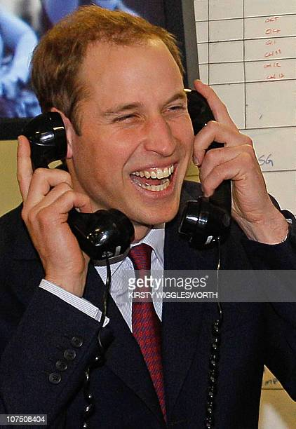 Britain's Prince William reacts as he completes a phone deal at ICAP brokers during their annual Charity Day in London on December 8 2010 100 % of...