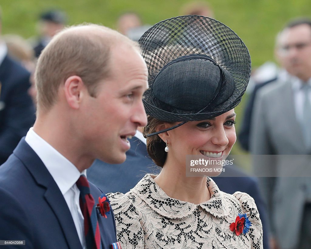 Britain's Prince William (L) speaks with French officials and his wife Britain's Catherine, Duchess of Cambridge smiles as they arrive in Thiepval, northern France, on July 1, 2016 to attend the Somme battle's centenary commemorations. One week after Britain's vote to leave the European Union, Prime Minister David Cameron and royal family members will stand side-by-side with France's President to celebrate their historic alliance at the centenary of the deadliest battle of World War I. / AFP / POOL / Francois Mori