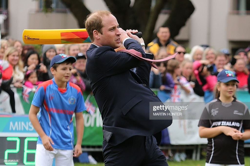 Britain's Prince William takes part in a game of cricket during a visit to Latimer Square in Christchurch on April 14 2014 Prince William his wife...