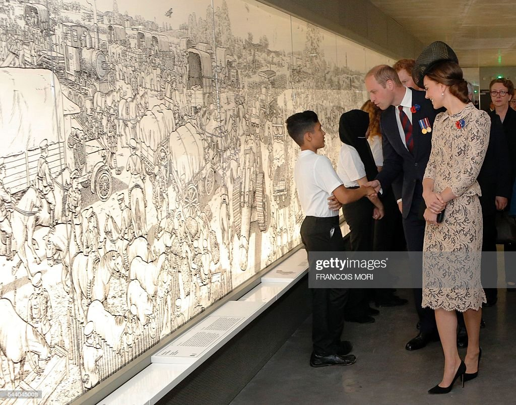 Britain's Prince William, the Duke of Cambridge (R), and his wife Kate, the Duchess of Cambridge, speak with children as they visit the World War I Thiepval monument northern France, on July 1, 2016, during the Somme battle's centenary commemorations. One week after Britain's vote to leave the European Union, Prime Minister David Cameron and royal family members will stand side-by-side with France's President to celebrate their historic alliance at the centenary of the deadliest battle of World War I. / AFP / POOL / Francois Mori