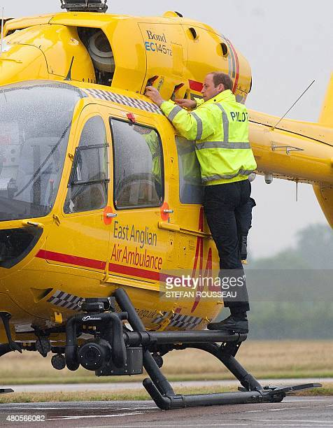 Britain's Prince William The Duke of Cambridge checks a helicopter air ambulance he begins his new job with the East Anglian Air Ambulance at...