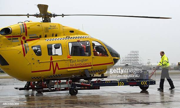 Britain's Prince William The Duke of Cambridge manoeuvres a helicopter air ambulance he begins his new job with the East Anglian Air Ambulance at...