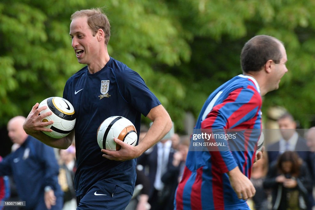 Britain's Prince William, the Duke of Cambridge takes part in a football training session in the garden of Buckingham Palace in central London on October 7, 2013, prior to a football match to mark the Football Association's 150th anniversary. Britain's Prince William warned footballers to watch the Buckingham Palace windows as Queen Elizabeth II's official residence staged the first football match in its 308-year history.