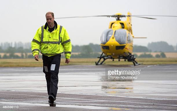 Britain's Prince William The Duke of Cambridge walks on the runway as he begins his new job with the East Anglian Air Ambulance at Cambridge Airport...
