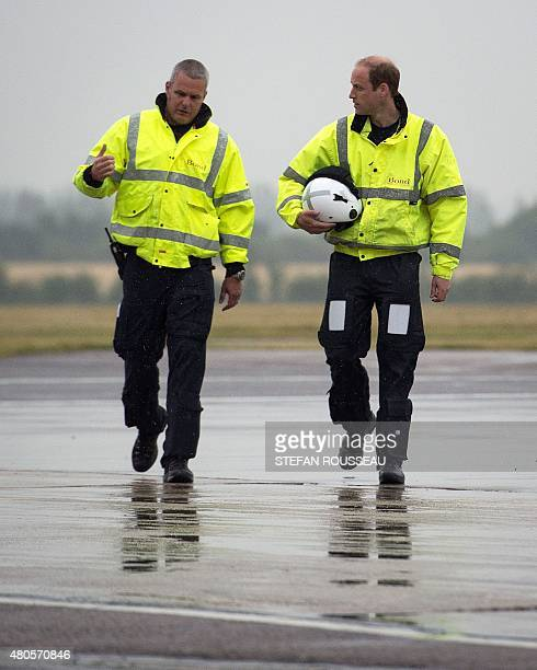 Britain's Prince William The Duke of Cambridge walks toward a helicopter air ambulance with Captain Dave Kelly as he begins his new job with the East...