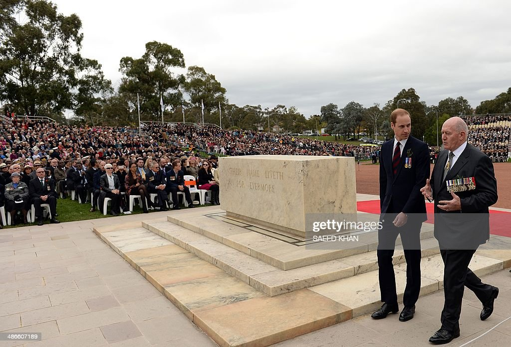 Britain's Prince William walks along with Peter Cosgrovce GovernorGeneral of the Commonwealth of Australia for the ANZAC Day march at the Australian...