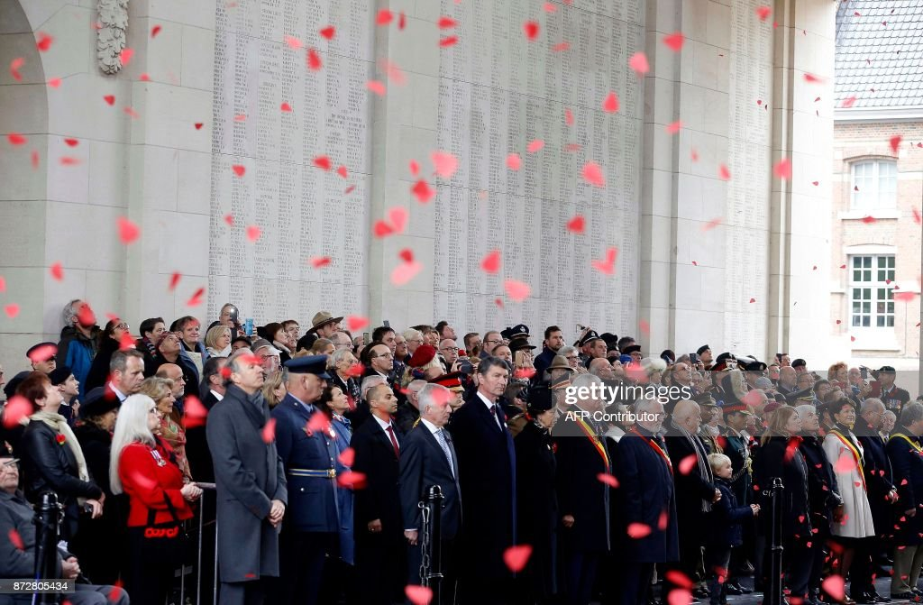 Britain's Princess Anne (C) pays a tribute during the Last Post ceremony at the Commonwealth War Graves Commission of the Ypres Memorial at the Menenpoort (Menin Gate) in Ieper - Ypres, on November 11, 2017 as part of the Armistice Day commemorations marking the end of WWI (World War I). / AFP PHOTO / BELGA / NICOLAS MAETERLINCK / Belgium OUT