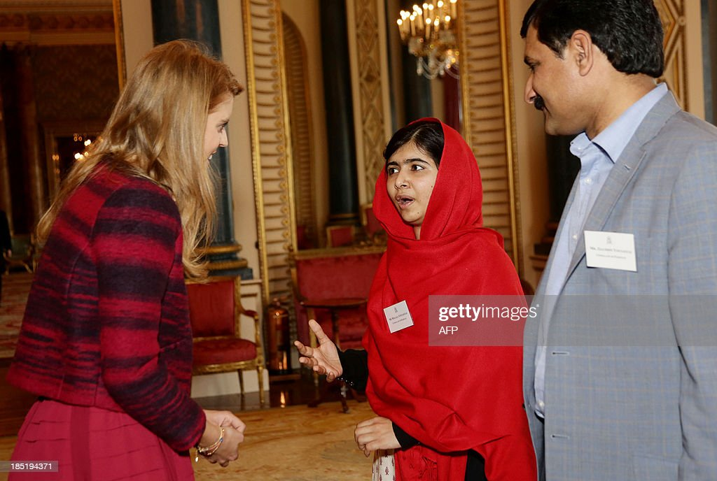 Britain's Princess Beatrice speaks with Malala Yousafzai (C) as her father Ziauddin Yousafzai (R) looks on during a Reception for Youth, Education and the Commonwealth at Buckingham Palace in London on October 18, 2013. The 16-year-old, who was shot by the Taliban for championing girls' rights to an education, met Queen Elizabeth at a reception for youth, education and the Commonwealth. Prince Philip, 92, joked that in Britain, people wanted their children to go to school to get them out of the house -- a comment that left Malala covering her face in a fit of giggles. AFP PHOTO/POOL/Yui Mok