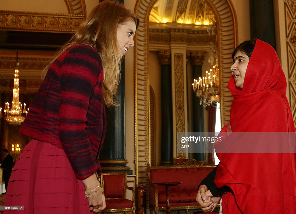 Britain's Princess Beatrice speaks with Malala Yousafzai (R) during a Reception for Youth, Education and the Commonwealth at Buckingham Palace in London on October 18, 2013. The 16-year-old, who was shot by the Taliban for championing girls' rights to an education, met Queen Elizabeth at a reception for youth, education and the Commonwealth. Prince Philip, 92, joked that in Britain, people wanted their children to go to school to get them out of the house -- a comment that left Malala covering her face in a fit of giggles. AFP PHOTO/POOL/Yui Mok