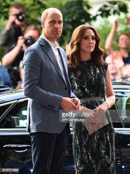 Britain's Princess Kate the Duchess of Cambridge and Britain's Prince William Duke of Cambridge arrive for a reception at 'Claerchens Ballhaus' dance...