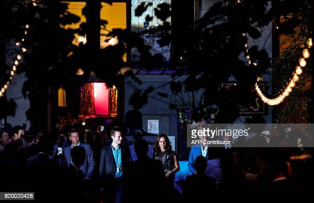 Britain's Princess Kate the Duchess of Cambridge Britain's Prince William Duke of Cambridge and Claerchen Ballhaus manager Nils Juergens leave after...
