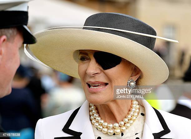 Britain's Princess Michael of Kent wears a patch over her left eye as she talks with guests during a garden party at Buckingham Palace central London...
