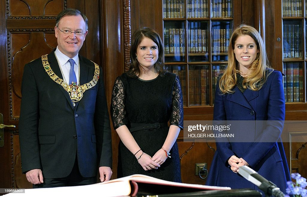Britain's princesses Eugenie (C) and Beatrice (R) are welcomed by mayor Stephan Weil (L) at the city hall in Hanover, eastern Germany on January 18, 2013. The granddaughters of the British Queen will also meet the Premier of Lower Saxony and attend the opening ceremony of the reconstructed palace in Hannover-Herrenhausen.