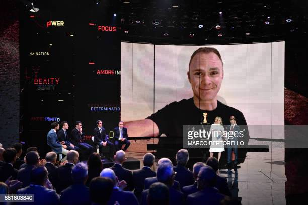 TOPSHOT Britain's pro cyclist Christopher Froome is seen on a video screen during the presentation of the 2018 Tour of Italy cycling race on November...