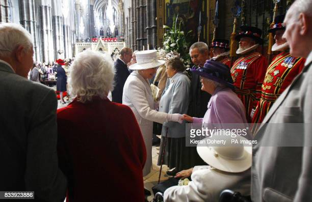 Britain's Queen Elizabeth and the Duke of Edinburgh greet couples who share their 60th anniversary after the service of celebration to mark the...