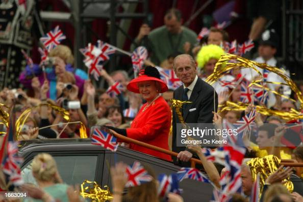 Britain's Queen Elizabeth and the Duke of Edinburgh ride at the head of a parade celebrating her Golden Jubilee to Buckingham Palace June 4 2002...