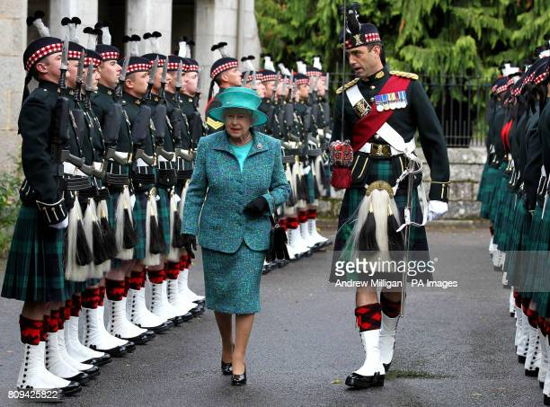 Britain's Queen Elizabeth II accompanied by Commanding Officer Major Nick WightBoycott inspects the Ballater Guard made up of soldiers from the...