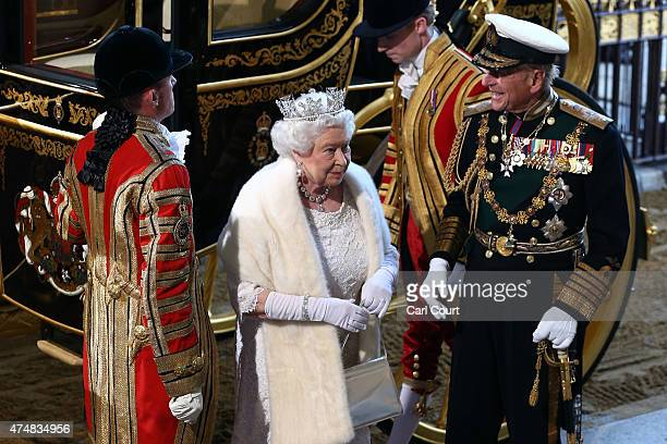 Britain's Queen Elizabeth II accompanied by her husband Prince Philip Duke of Edinburgh arrives for the State Opening of Parliament at the Houses of...