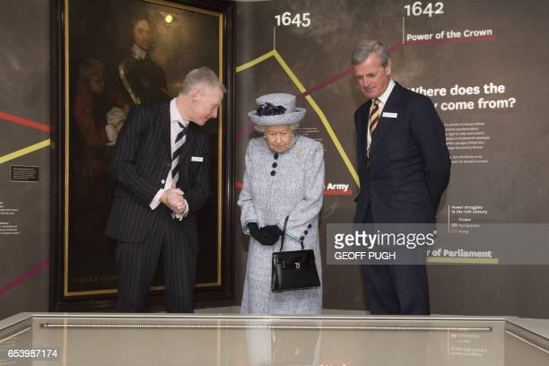 Britain's Queen Elizabeth II accompanied by Ian Maine the assistant director visits the newly refurbished National Army Museum in central London on...