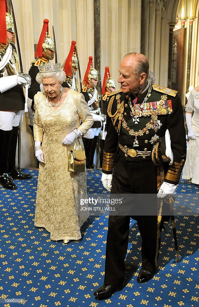 Britain's Queen Elizabeth II (L) accompanied by Prince Philip arrive at the top of the Norman stairs in the Houses of Parliament, before the State Opening of Parliament, in London, on May 25, 2010. Queen Elizabeth II set out the new coalition government's legislative programme on Tuesday in a ceremony of pomp and history following the closest general election for decades.