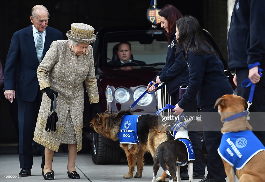 Britain's Queen Elizabeth II accompanied by Prince Philip, Duke of Edinburgh (L) attend the opening of the new Mary Tealby dog kennels at Battersea Dogs and Cats Home in London on March 17, 2015.