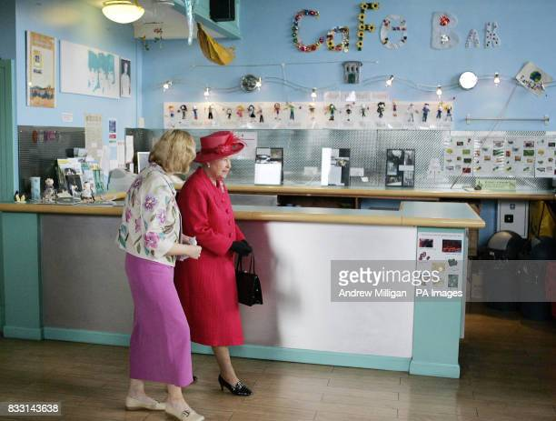 Britain's Queen Elizabeth II accompanied by The Shore manager Grace Chalmers during a tour The Shore where she met young people staff and volunteers