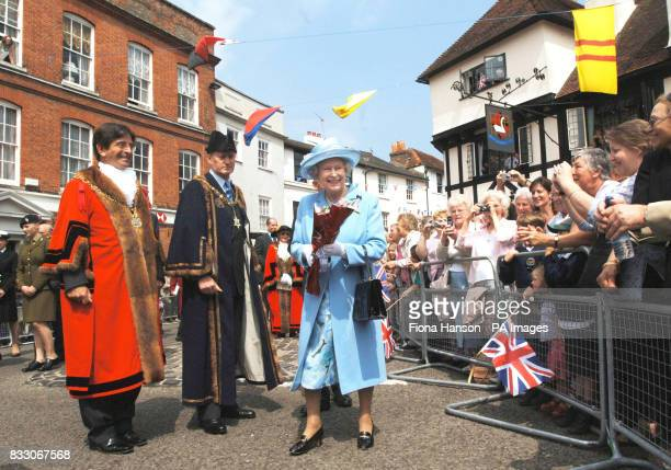 Britain's Queen Elizabeth II accompanied by town Mayor Mark Cooper left and Lord Brabourne is greeted by crowds of well wishers outside Romsey Abbey...