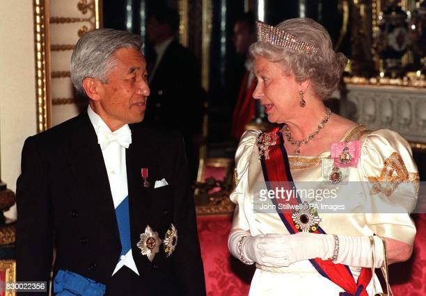 Britain's Queen Elizabeth II accompanies Japanese Emperor Akihito to the State Banquet Hall at Buckingham Palace this evening The Japanese Emperor is...