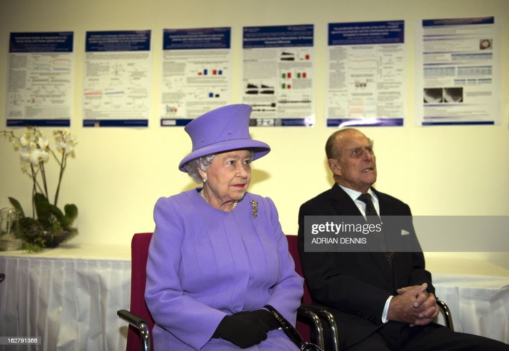 Britain's Queen Elizabeth II (L) alongside Prince Philip, Duke of Edinburgh (R), listen to a welcome speech during a visit to the new National Centre for Bowel Research and Surgical Innovation in London on February 27, 2013. The Queen accompanied by the Duke of Edinburgh toured the new Royal London Hospital building, visiting the new Children's Services area meeting patients and staff. They also visited the new National Centre for Bowel Research and Surgical Innovation where they toured state-of-the-art laboratories dedicated to the study of human tissue.