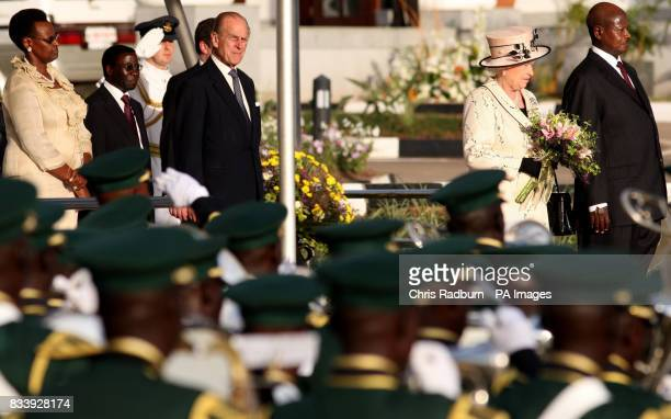 Britain's Queen Elizabeth II alongside the Ugandan President Yoweri Museveni and the Duke of Edinburgh during there arrival at the State House...