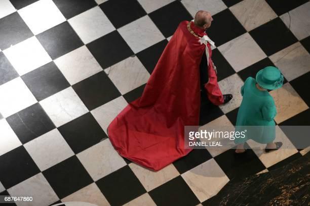 Britain's Queen Elizabeth II and Britain's Prince Philip Duke of Edinburgh attend a service to mark the Centenary of the Order of the British Empire...